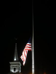 The American flag flew at half-staff in Newton, Conn.